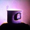 Matthew Schreiber and Daniel Newman<br> <i>The Mug of Aleister Crowley</i>, 2014<br> Hologram<br> 11 x 11 inches (27.94 x 27.94 cm)<br>